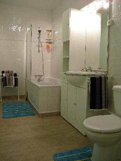 The bathroom with bath and shower