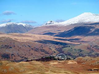 Winter view of Boot Village (circled) beneath snowcapped Scafell