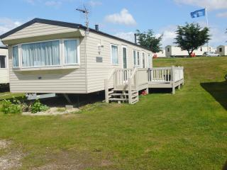 Ref 90008 Kessingland Beach 8 berth Beautiful caravan with decking .