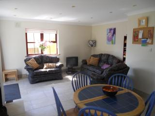 Sitting Room view consisting of coach and two armchairs, nest of tables, satelite Tv and DVD