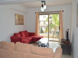 Comfortable lounge with 2 L Shaped sofas, Flat screen TV, DVD, Memory Unit with lots of movies