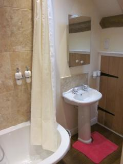 Your en-suite bathroom is a tranquil haven with toiletries and all towels provided.