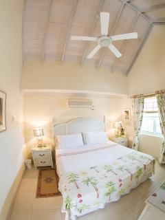 Master Bedroom king size bed cool cotton linen and high ceilings. pic taken with a fish eye lens..
