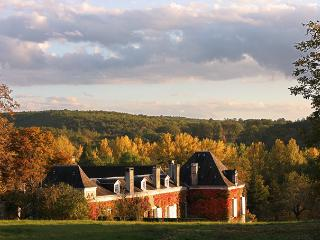 View of La Chartreuse du Maine from the pool in Fall