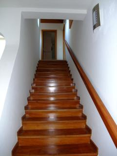 Solid wood stair to the 1st floor