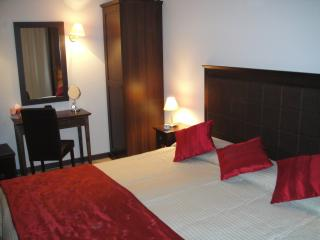 Master Bedroom - with air-conditioning and extra large double bed which can be split in 2 x singles