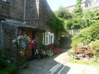 Pretty exterior with patio seating for 4, car parking area for 2 cars, pubs and shop within walking