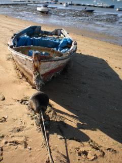 working boats on morning beach walk