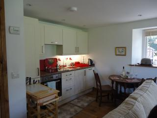 Kitchen end of the living room. Well equipped kitchen with large fridge, freezer and dishwasher.