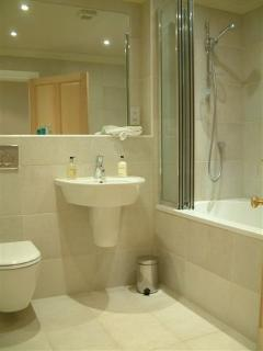 Bathroom with extra deep bath and shower in two bed lodge