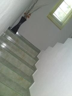 Stairs. Please be aware that there is no hand rail on the top flight and the floors are marble