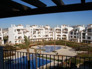 Penthouse apartment, balcony plus large sun terrace with pool & golf views
