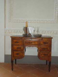 smarlty furnished with precious antiques, ........