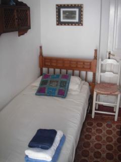single bedroom with balcony overlooking street