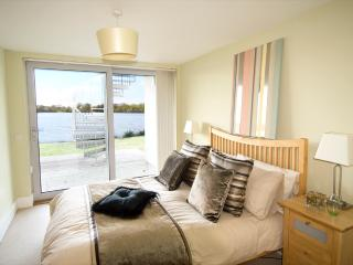 En suite Master Bedroom with lakeviews and direct access to private deck