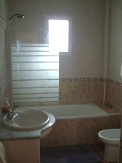 The upstairs bathroom, has a full size bath and plenty of storage