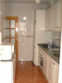 The kitchen is fully equipped and has dining area and uti;iy area in the back garden with a washing