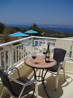 Enjoy a glass of wine whilst enjoying te views