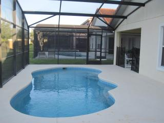 Heated pool with screen enclosure
