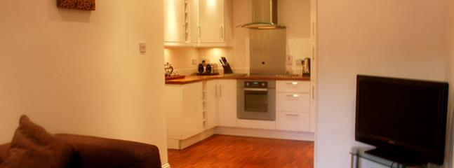 View from lounge into fully equipped kitchen