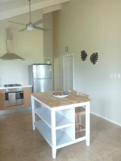 Oak kitchen with island bench.