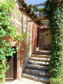 The ancient steps over the pizza oven to front door upstairs