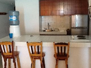 Kitchen. The counter top and stove top were changed   See other photo