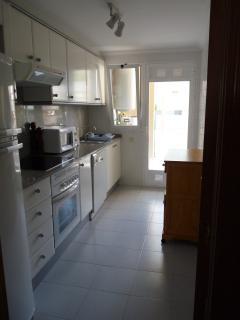Kitchen leading to utility room & Garden