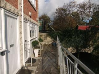 Gated patio area to the front of the house, overlooking the stream and the railway line.