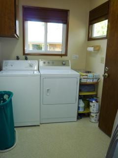 Utility Room with washer and dryer, back door toward the deck on the right