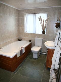 Fully tiled modern family bathroom