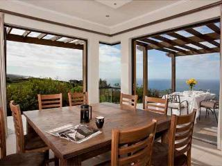 Dining room overlooking golf course and ocean