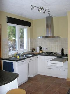 Well equipped modern kitchen off dining area
