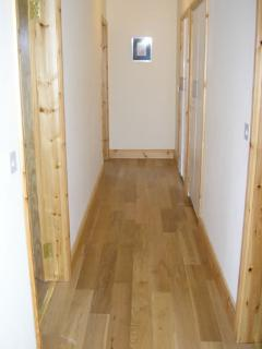 42' wide corridor leading to bedrooms and main shower room