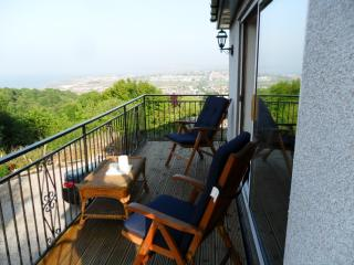 BALCONY SEATING AREA.RECLINING CHAIRS.MORNING COFFEE ANYONE...