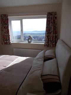Front King size en-suite Bedroom with views of the coastline.