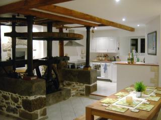 The kitchen and dining area of the Ground Floor showing the old Mill Wheel workings.