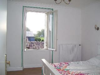The bright double bedroom has fitted wardrobes and lots of space to spread out.