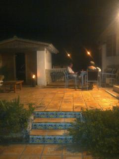 Sauna and terrace area at night, house has security lights the whole way around it