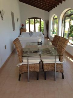 The Naya - indoor lounging / dining area over looking pool