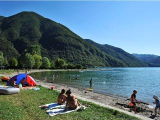 The private sandy beach with breathtaking views of Lake Lugano