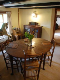 The dining room seats up to six people and also houses our beautiful rocking horse!