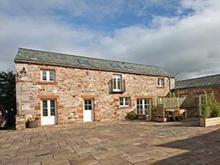 East Byre, within the peaceful sanctuary of Salutation Yard, in unspoilt Skelton, Lakeland, Cumbria