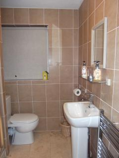 Shower Room fully tiled.