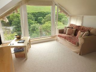 showing the beautiful floor to ceiling windows that show off the fantastic country side scenary