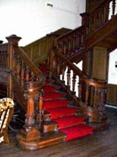 Oak staircase leading to minstrals gallery
