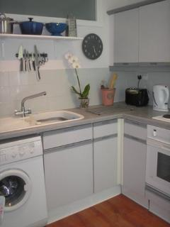 Kitchen is fully equipped with Washing Machine, Cooker, Microwave, Fridge and Dish washer (right).