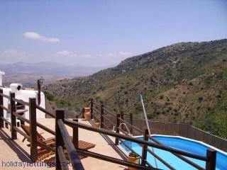 View from top terrace across pool to mountain views.