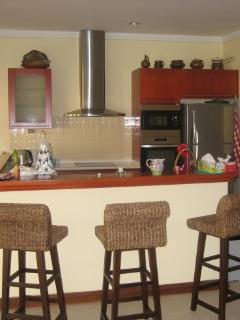 Breakfast bar to incredibly well stocked kitchen
