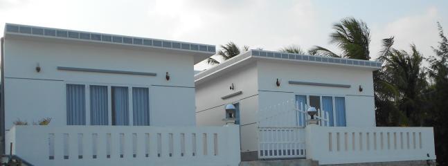 Bahía de casa (derecha) y Bay House 2